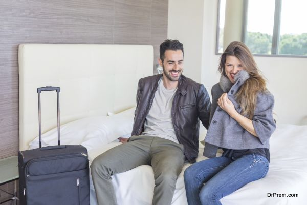 Young Couple Relaxing at Hotel Room
