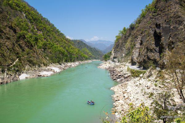 Gang river valley and rafting boat near Rishikesh