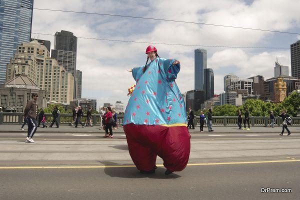 Clown on stilts on parade